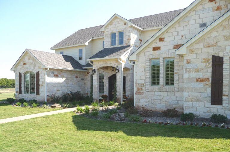 Residential Home Landscaping, lawn plantings, shrubs, rocks, and flowers in Waco