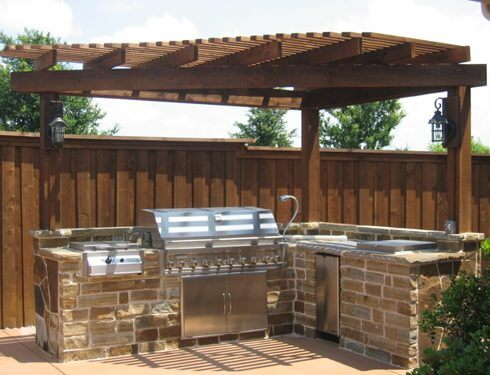 Backyard patio & grill with gazebo built by Fitzgerald's Landscape Design team.