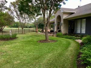 Residential landscaping and tree care with tree mulch and garden mulch
